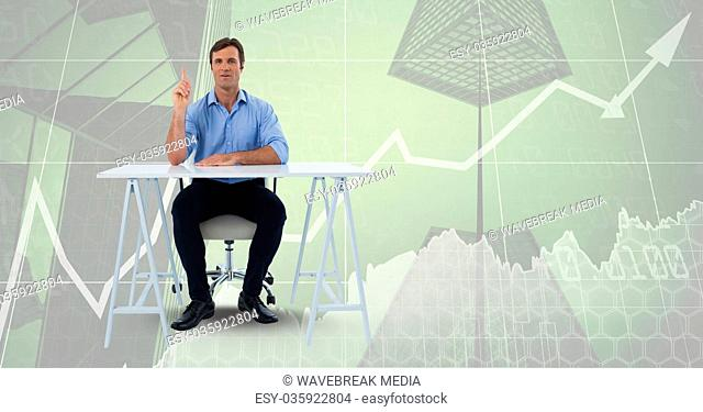 Man sitting at desk on collage of graph and skyscrapers