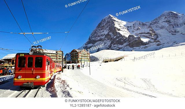 Jungfraujoch train at Kleiner Scheidegg in winter with The Eiger left then The Monch Mountains  Swiss Alps Switzerland