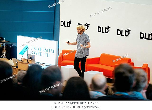 BAYREUTH/GERMANY - JUNE 21: Cyborg Neil Harbisson (Cyborg Org) with his antenna gestures speaking on the stage during the DLD Campus event at the University of...