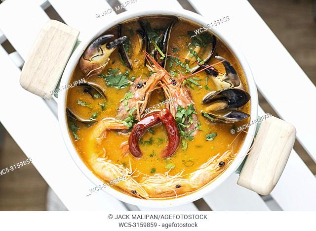 mixed fresh creamy spicy seafood soup bowl