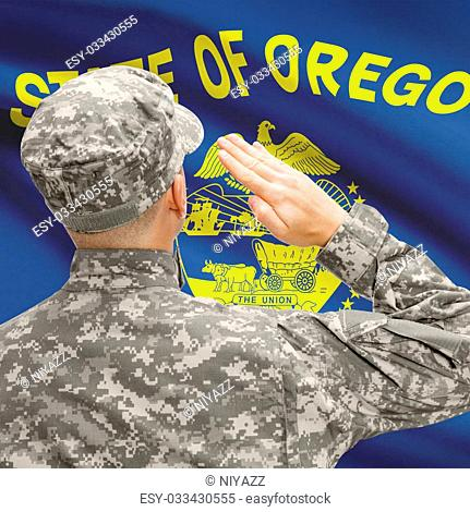 Soldier saluting to USA state flag conceptual series - Oregon