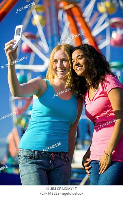 Friends taking a Photo with a Cell Phone at an Amusement Park, York Region, Ontario