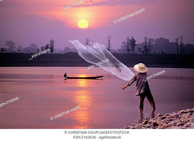 cast net fishing on Mekong River at sunset in northeastern Thailand, Southeast Asia
