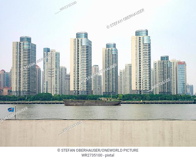 China, Shanghai, view over the river of Shanghai with residential buildings in the background