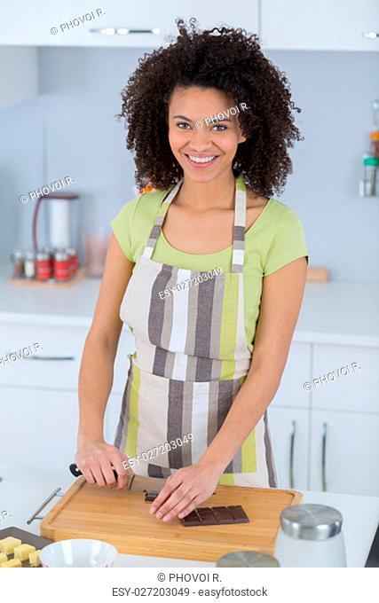 portrait of a black woman cookingchocolate cake
