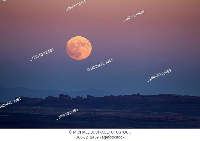 The full moon or supermoon rises over Monument Valley on Navajo Tribal Land on the Utah/Arizona border