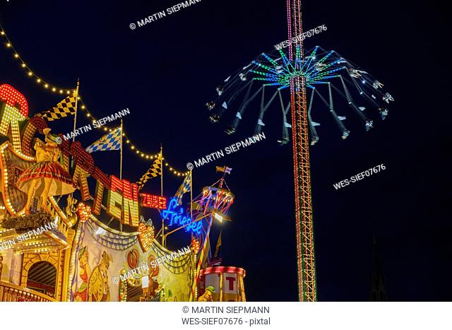 Germany, Bavaria, Munich, View of Oktoberfest fair, Labyrinth and Jule Verne Tower at night