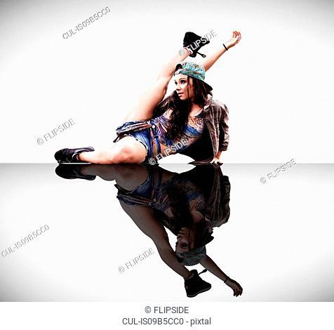 Dancer posing on studio floor