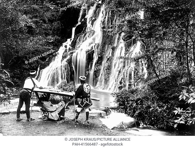 Waterfall near Yumoto Nikko with lady in a palaquin. Pictured in the early 1920th. - /Japan