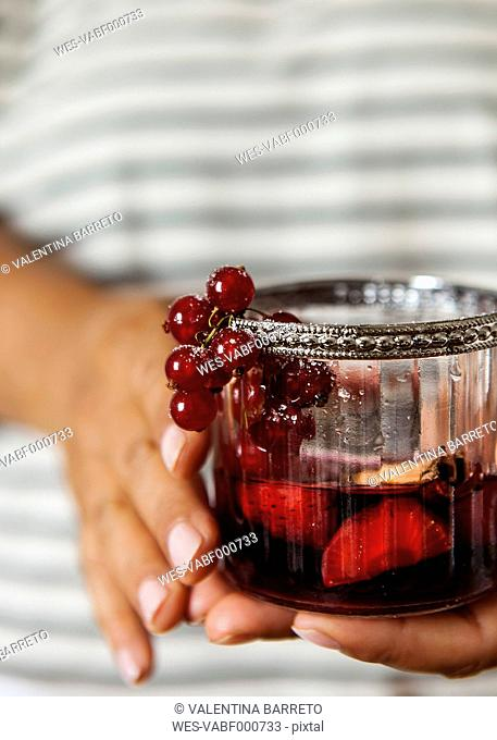 Woman's hands holding glass of Sangria