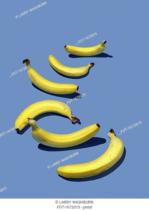 High angle view of bananas on purple background
