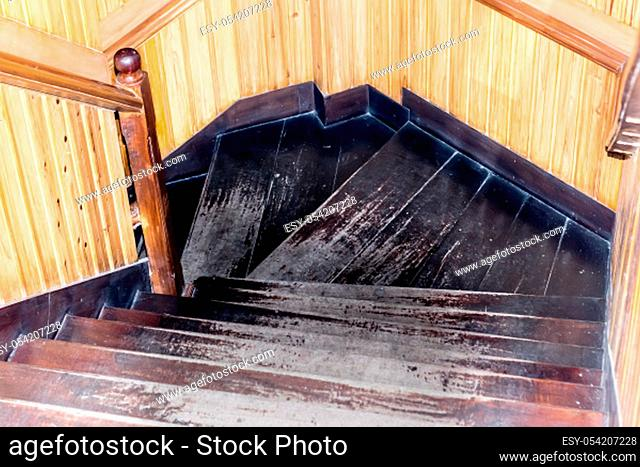 Modern style staircase with wooden steps and handrail. Spiral design Hardwood material Stairs Wood Steps interior. Residential or office building inside a house