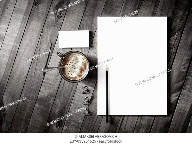 Blank corporate stationery template on vintage wooden table background. Branding mock-up. Top view