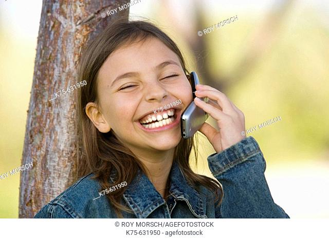 Girl talking and laughing on cell phone
