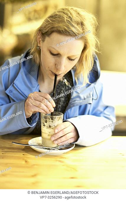 Young woman in cafe, Munich, Germany