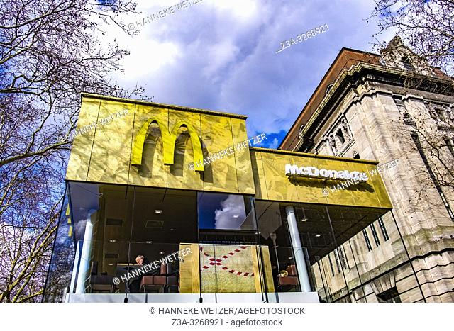 Modern Mc Donald's building in front of old post office in Rotterdam, the Netherlands, Europe