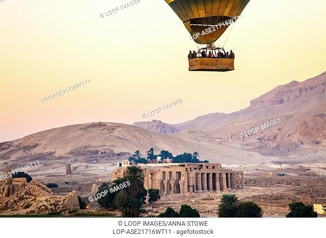 Hot air balloon flying over the Ramesseum on the West Bank of the Nile in Egypt