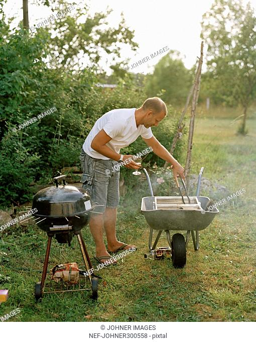 A man with an outdoor grill