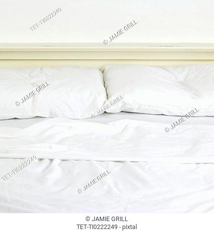 Still life of an unmade bed