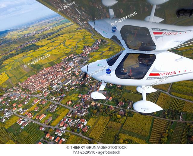 France, Haut Rhin 68, Wines road, Riquewihr, Ultralight plane Pipistrel Virus SW flying over vineyards during autumn aerial view