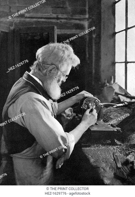 A watch cap maker at work, 1911-1912. From Penrose's Pictorial Annual 1911-1912, The Process Year Book, volume 17, edited by William Gamble and published by AW...