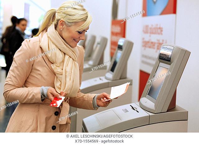 woman checks her bank account