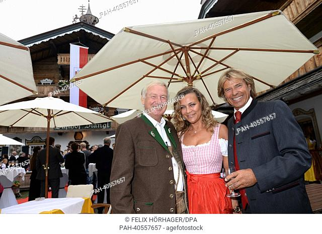 HotelStanglwirt owner Balthasar Hauser (L), singer Hansi Hinterseer (R) and his wife Ramonapose prior to the GoldenRouletteBall award ceremony at Hotel...