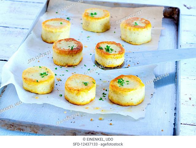 Potato cakes on a baking tray