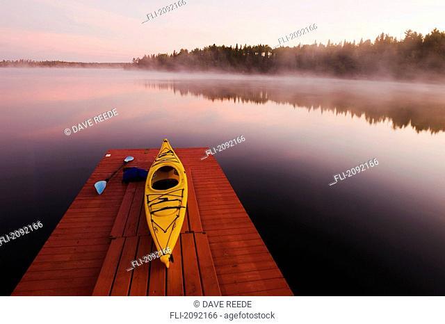Kayak on dock in northwestern ontario, lake of the woods ontario canada