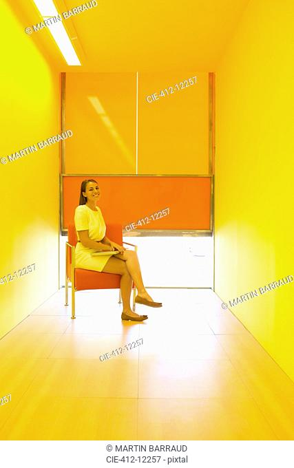 Businesswoman sitting in bright office