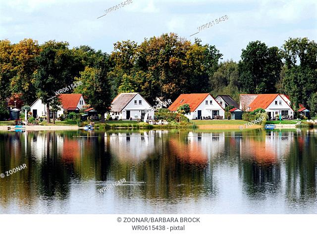 Houses with red roofs at the see, summertime