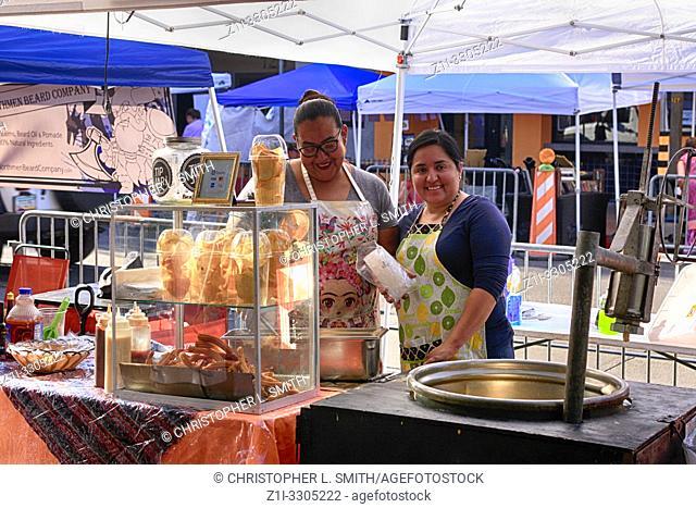 Women selling Churros at a street market in downtown Tucson, AZ