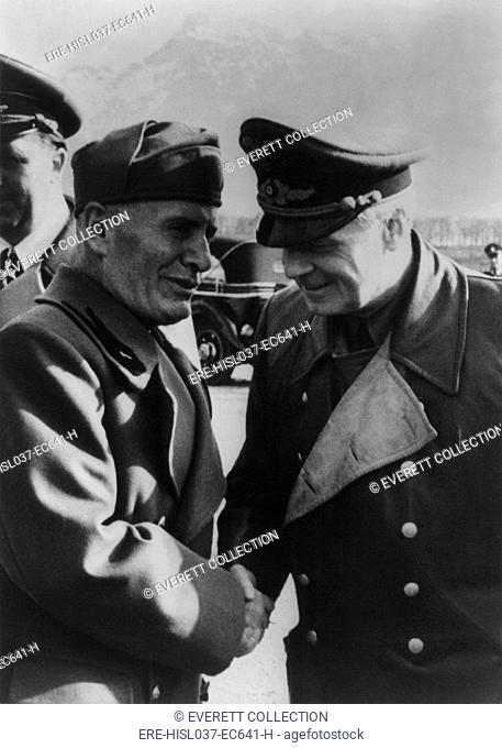Mussolini greeting Joachim von Ribbentrop, with the German ambassador to Italy, Rudolf Rahn. April 25, 1944. 10 months earlier