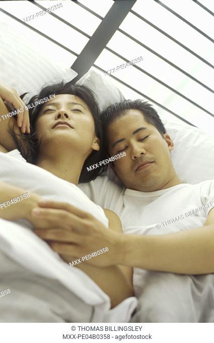 Young asian couple sleeping