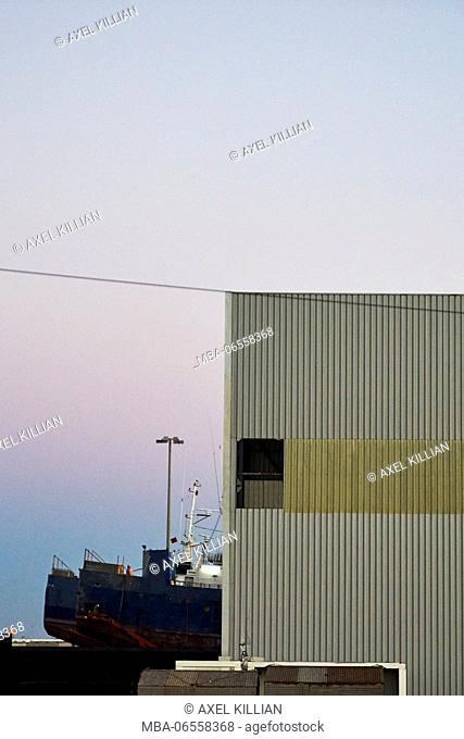 Ship in a shipyard near the town at the harbour, detail, hall, sky