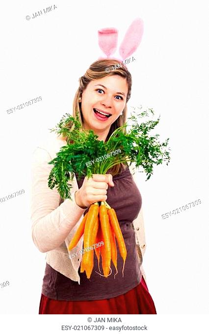 Funny woman with bunny ears holding carrots