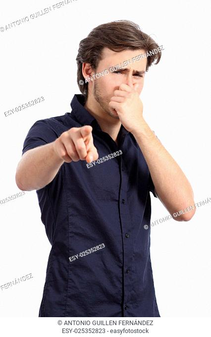 Man pointing at you with hand holding nose because bad stink isolated on a white background