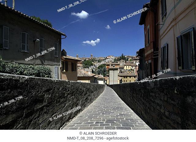 Empty aqueduct passing through a village, Perugia, Umbria, Italy