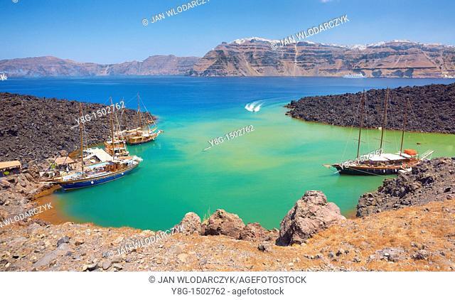 Excursion boats at the harbour of Nea Kameni Island, Santorini, Cyclades, Greece