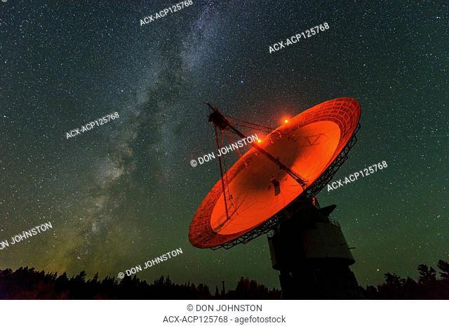 Night sky and the Radio telescope dish at Algonquin Radio Observatory, Algonquin Provincial Park, Nipissing Township, Ontario, Canada