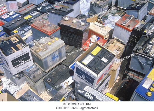 A pile of car batteries ready for disposal