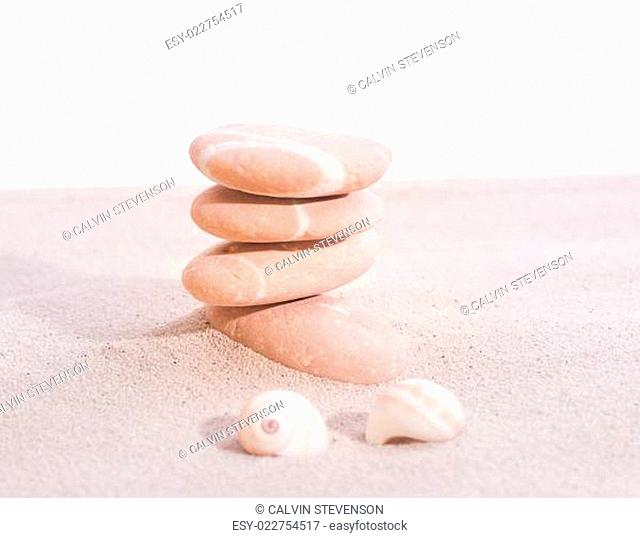 Stones and sea shells on sand close-up