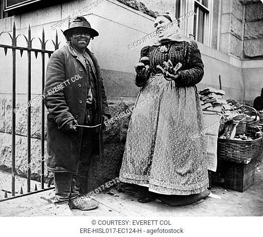 New York City street types: Emigrant man and women pretzel vendor. 1896 photograph by Alice Austen