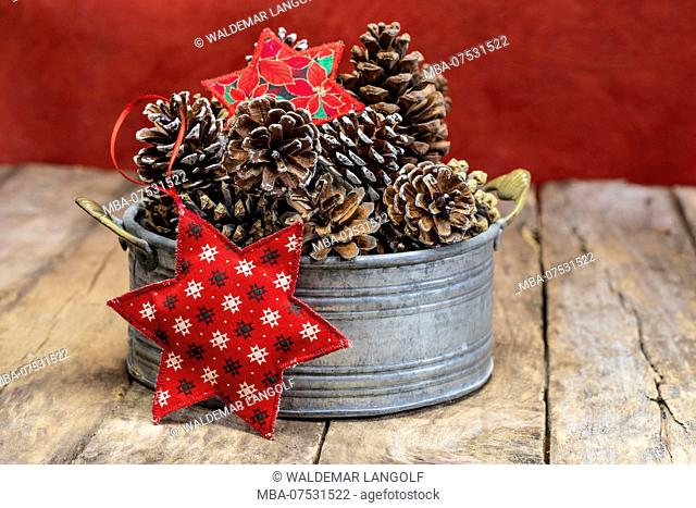 Christmas decoration with cones and textile stars