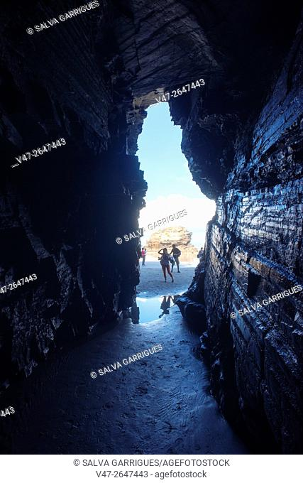 People walking through the caves of the Beach of the cathedrals, Playa de Augas Santas, Ribadeo, Lugo, Galicia, Spain, Europe