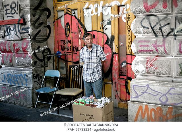 A street vendor waiting for clients in a shopping street near Omonia square in Athens, Greece on the 2nd of July 2015. Greece's government has made new...