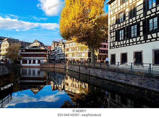 Petit France medieval old town district of Strasbourg with canal and reflections, Alsace France, retro toned