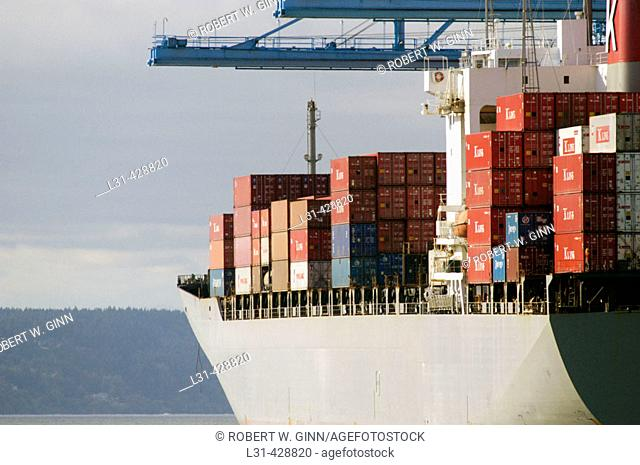 Shipping containers and ships at the port of Tacoma, Washington. USA