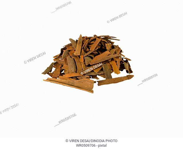 Spices , cinnamon sticks or bark on white background