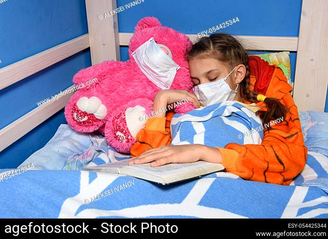 Sick girl in medical mask fell asleep in bed